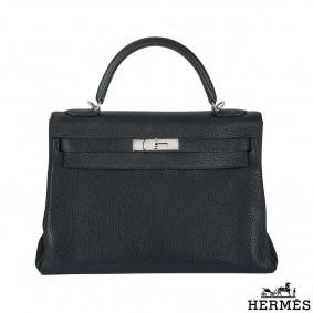 Hermes 32 cm Kelly handbag with an additonal Fendi Strap